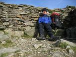 Sheltering from the chilly early morning wind on top of Helvellyn