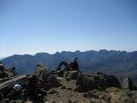 In relaxing pose at the summit of Bla Bheinn
