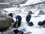 Putting on the crampons and harness