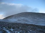 Looking up to the bare, exposed summit of Cairn Gorm